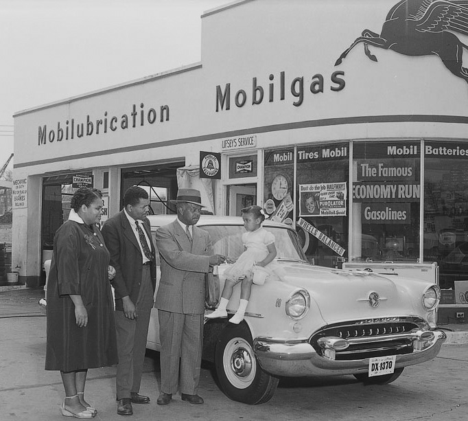An African-American family with their new Oldsmobile in Washington, D.C., 1955