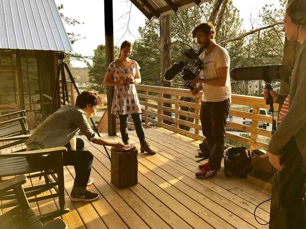 Adam Forrester films Blue Delliquanti and Chelsea Thomas on the deck of AIR Serenbe's Rural Studio cottages.