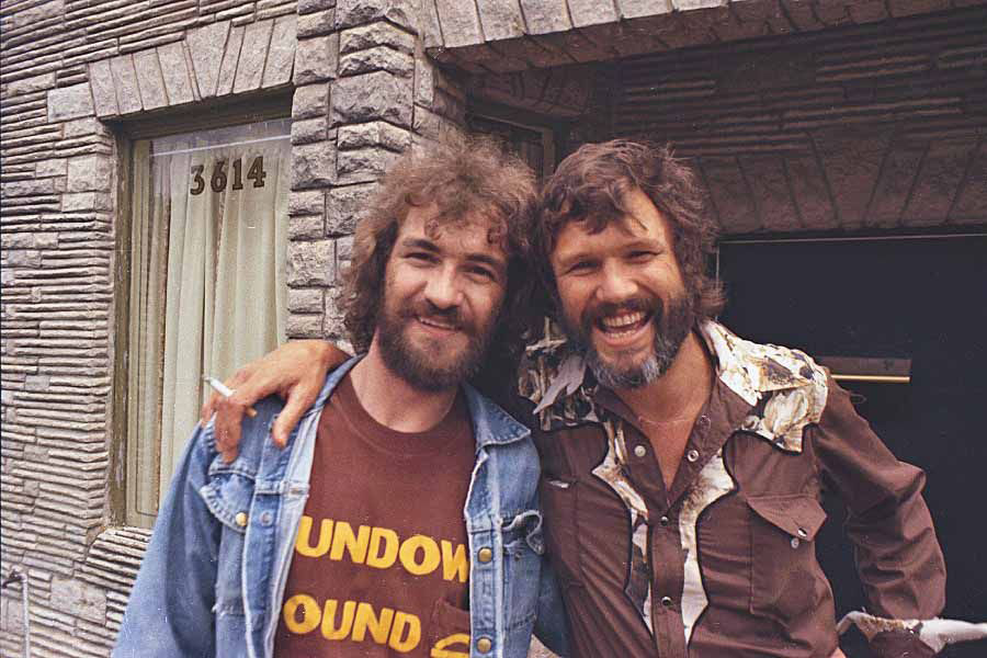 Donnie Fritts and Kris Kristofferson in front of Muscle Shoals Sound Studios in the 1970s.
