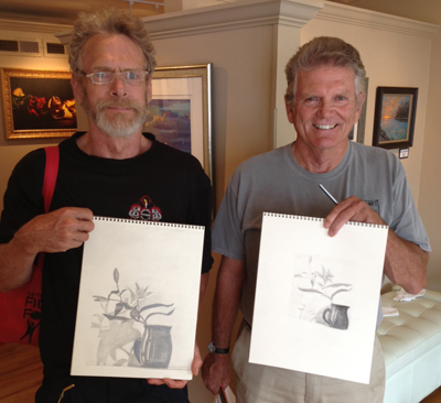 Dr. Barney Vincellette and Joe Larrimore show off their class sketches.