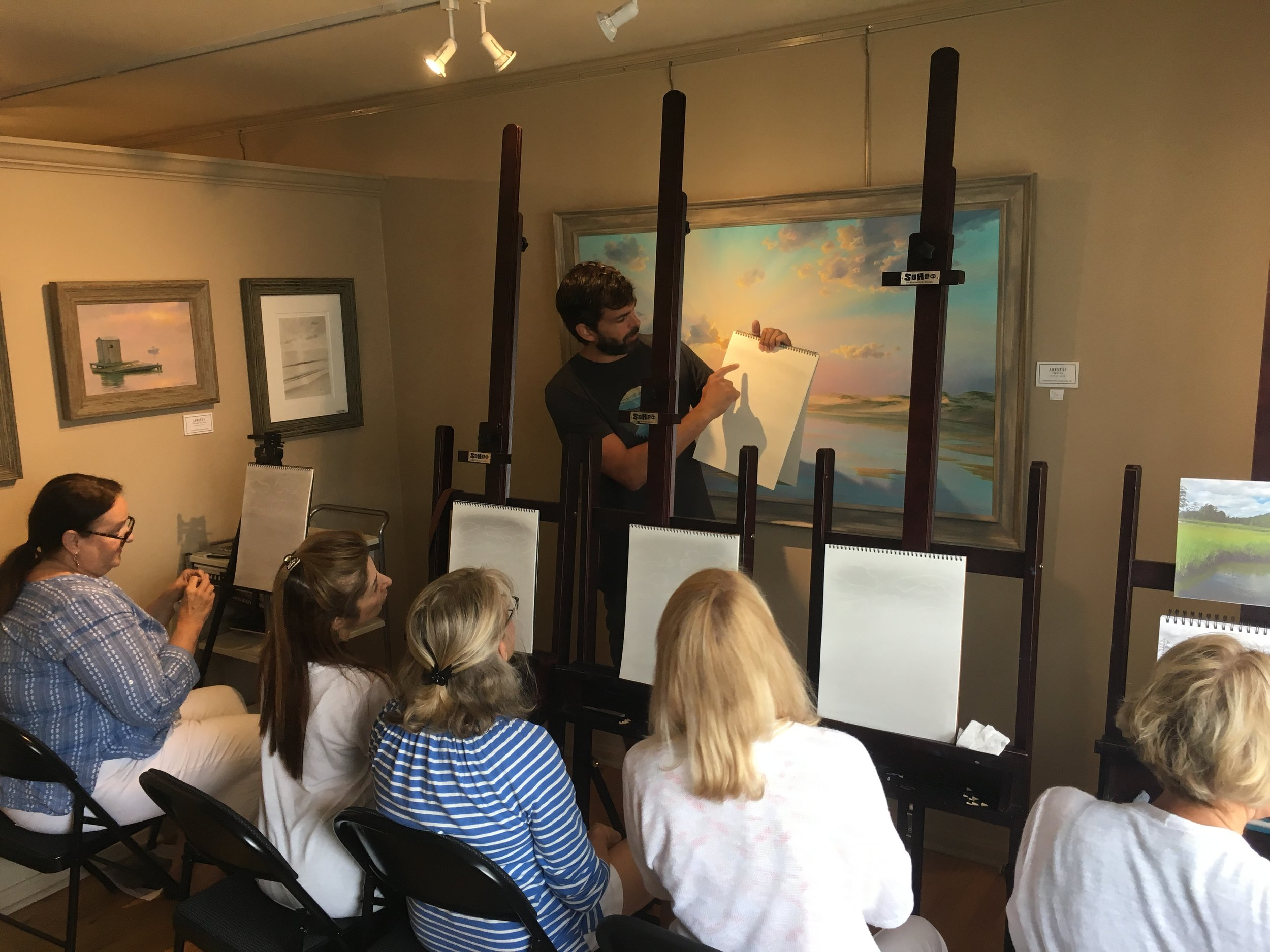 Abraxas demonstrating sketching techniques at his studio. Demonstrations and explanations ensure understanding even by those who say they can't draw!