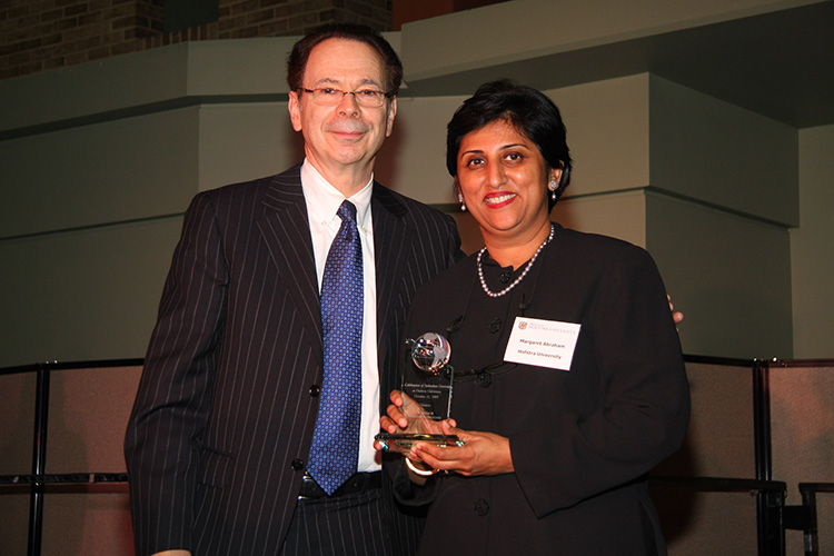 Receiving the 2009 Diversity Award from the National Center for Suburban Studies, Hofstra University in recognition for leadership and work on the Diversity Task Force.