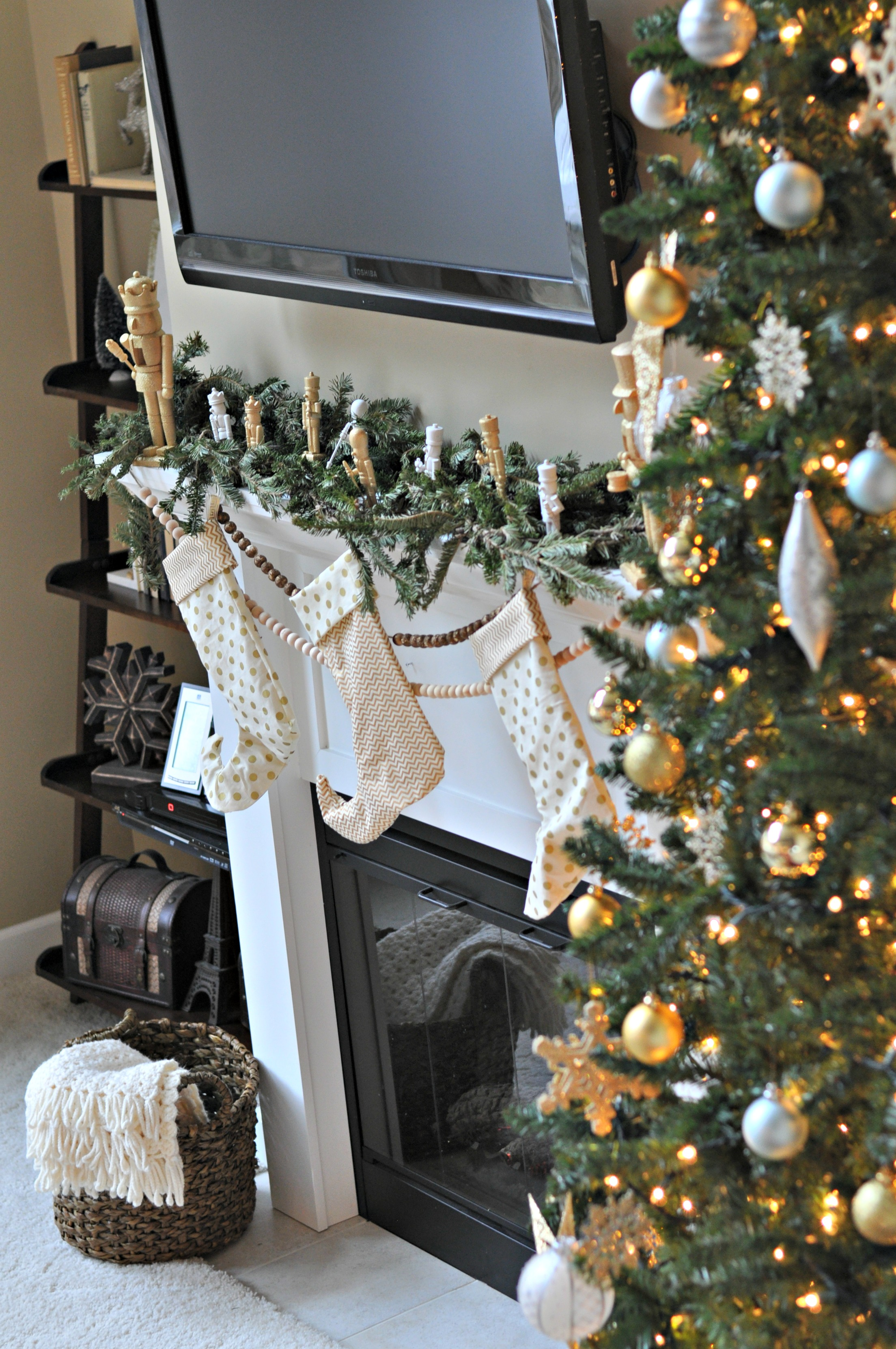 Holiday Mantel.  Gold and nutcrackers..jpg