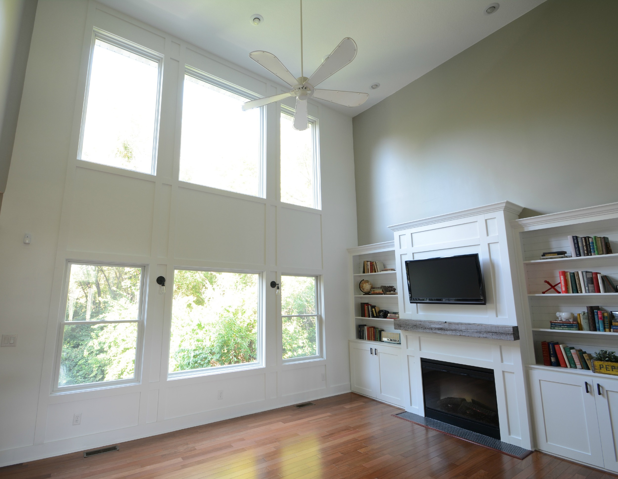 Add molding to a wall two story living room