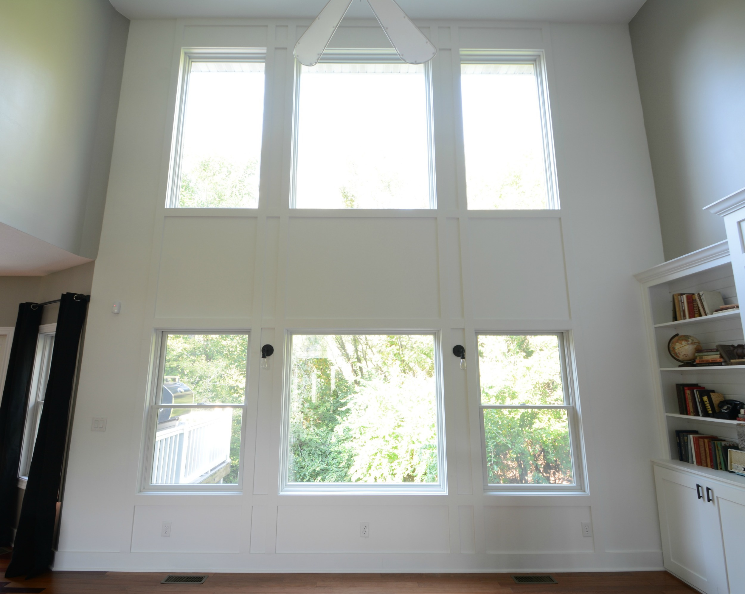 Add molding to a two story living room wall