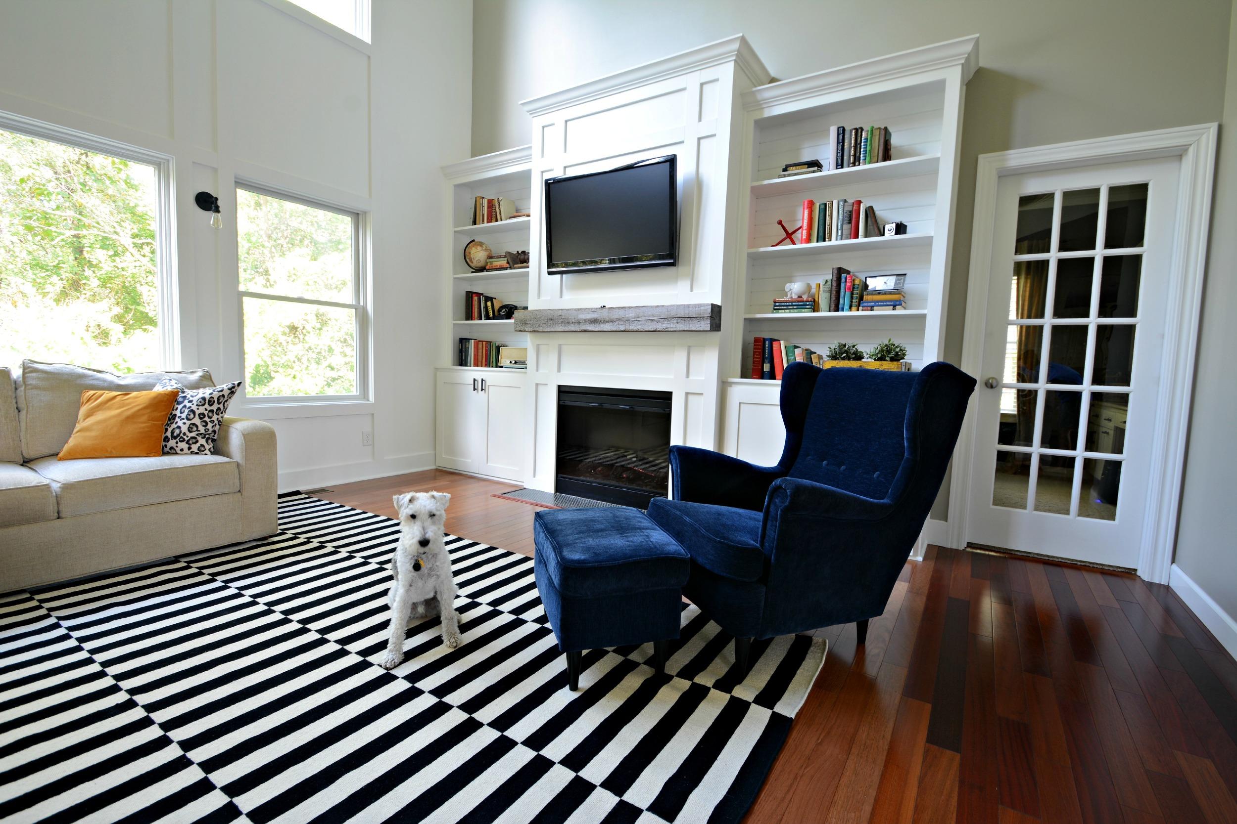 Living Room Updates {IKEA Stockholm Rug} Black, White, Navy. Barn Beam Mantel Built-ins. Books.