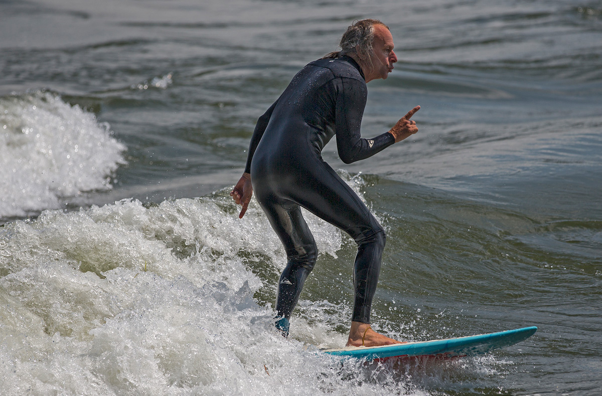 MONTREAL, QC. AUGUST 16 2013 -- A man rides the running wave in Lasalle, just off the island of Montreal in the St. Lawrence river on Friday, August 16, 2013. (Leslie Schachter/unpublished)