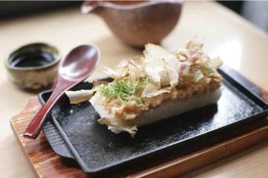 Szechuan Spiced Salmon with Bonito Flakes over Crispy Rice at Neta