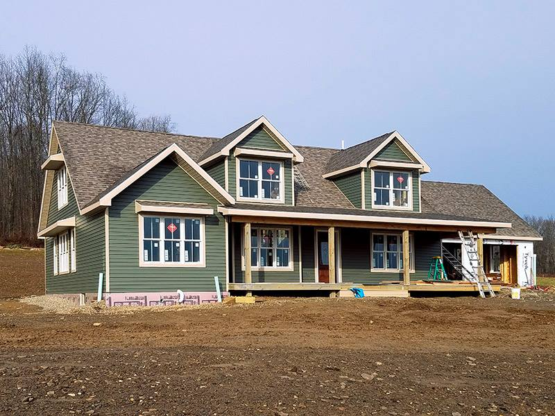 Construction Progress: Exterior Siding, Roofing and Windows Installed.