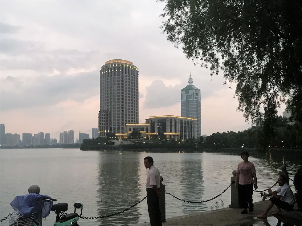 Our temporary home: the Grand New Century Kaimei Hotel, towering above the lake where we rowed in Nanchang.