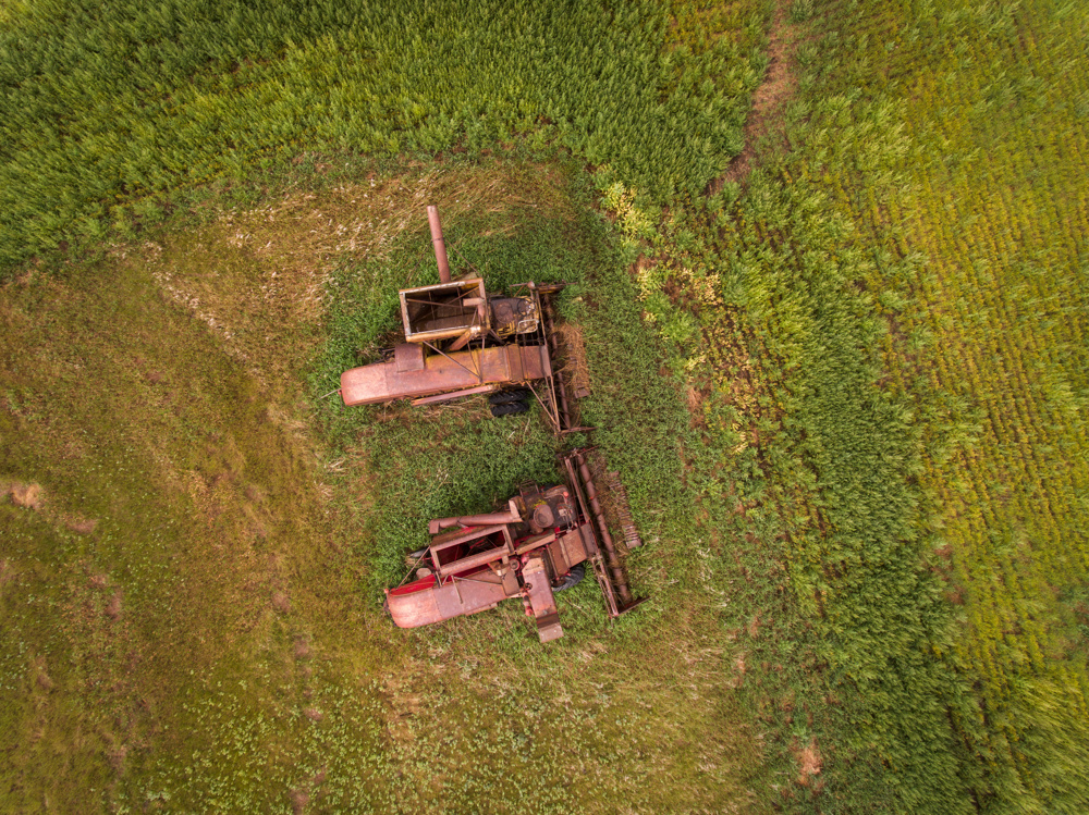 Retired combines on an old farmstead near Travers Reservoir