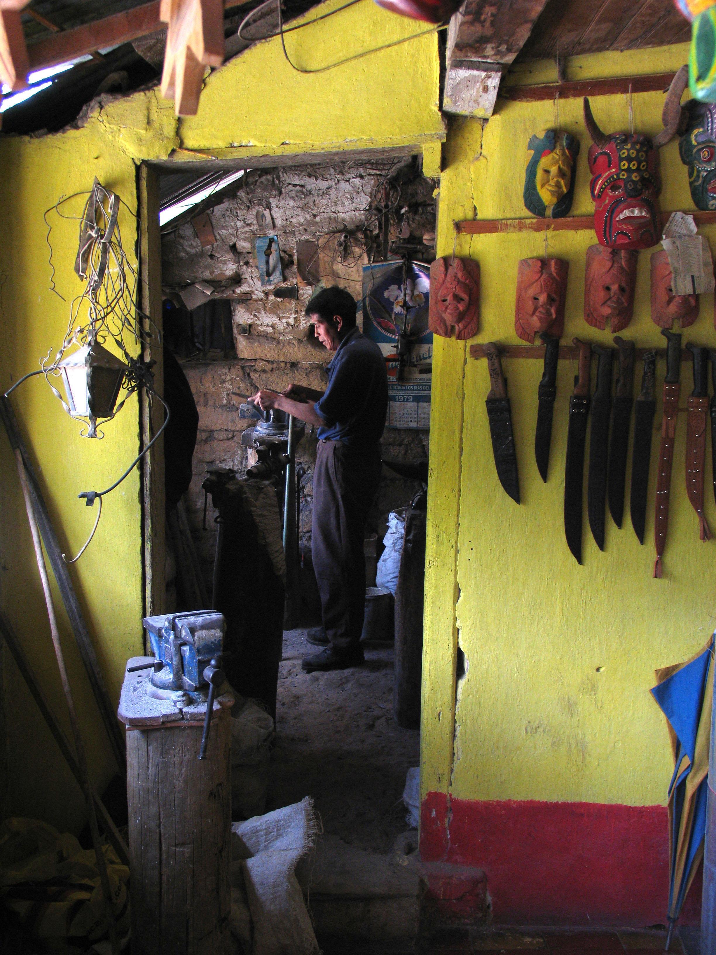 Knife maker, Chichicastenango, Guatemala
