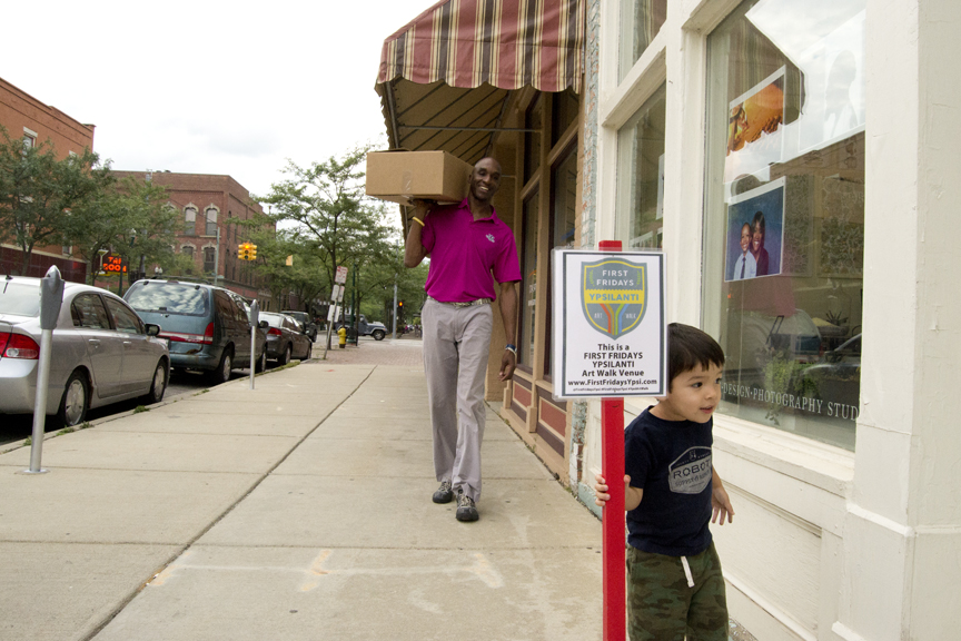 Ypsilanti Community School's superintendent Dr. Benjamin Edmondson brings a special delivery.