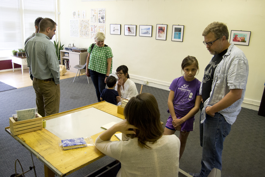 Mark Maynard and his daughter learn about the book binding process.