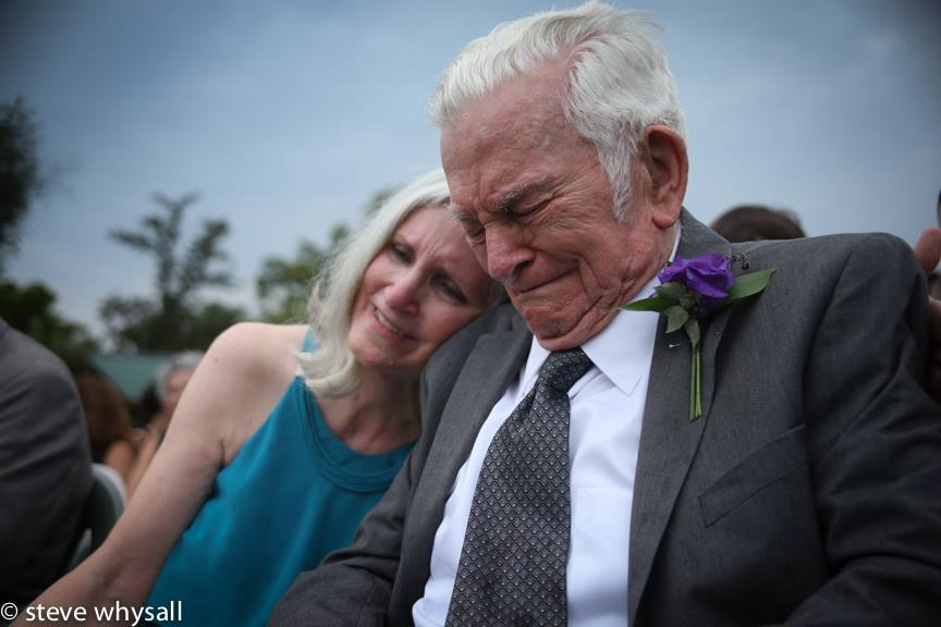 This is the grandfather of the groom with his daughter, the mother of the groom at the wedding ceremony. He gave his late wife's wedding ring to the bride. It touches my heart every time I look at this photo.