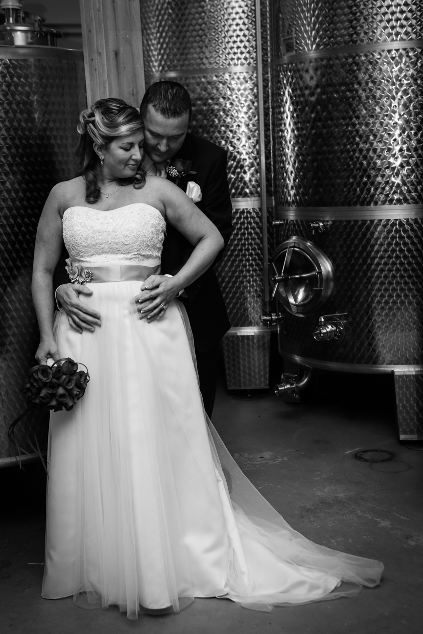 Bride and Groom in Wine Cellar 8 Chains North Winery
