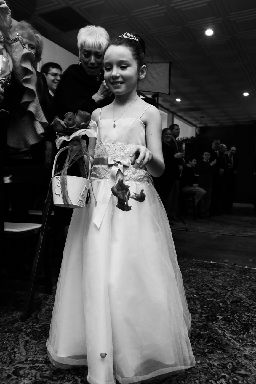 Flower girl dropping flowers wedding ceremony 8 Chains North Winery
