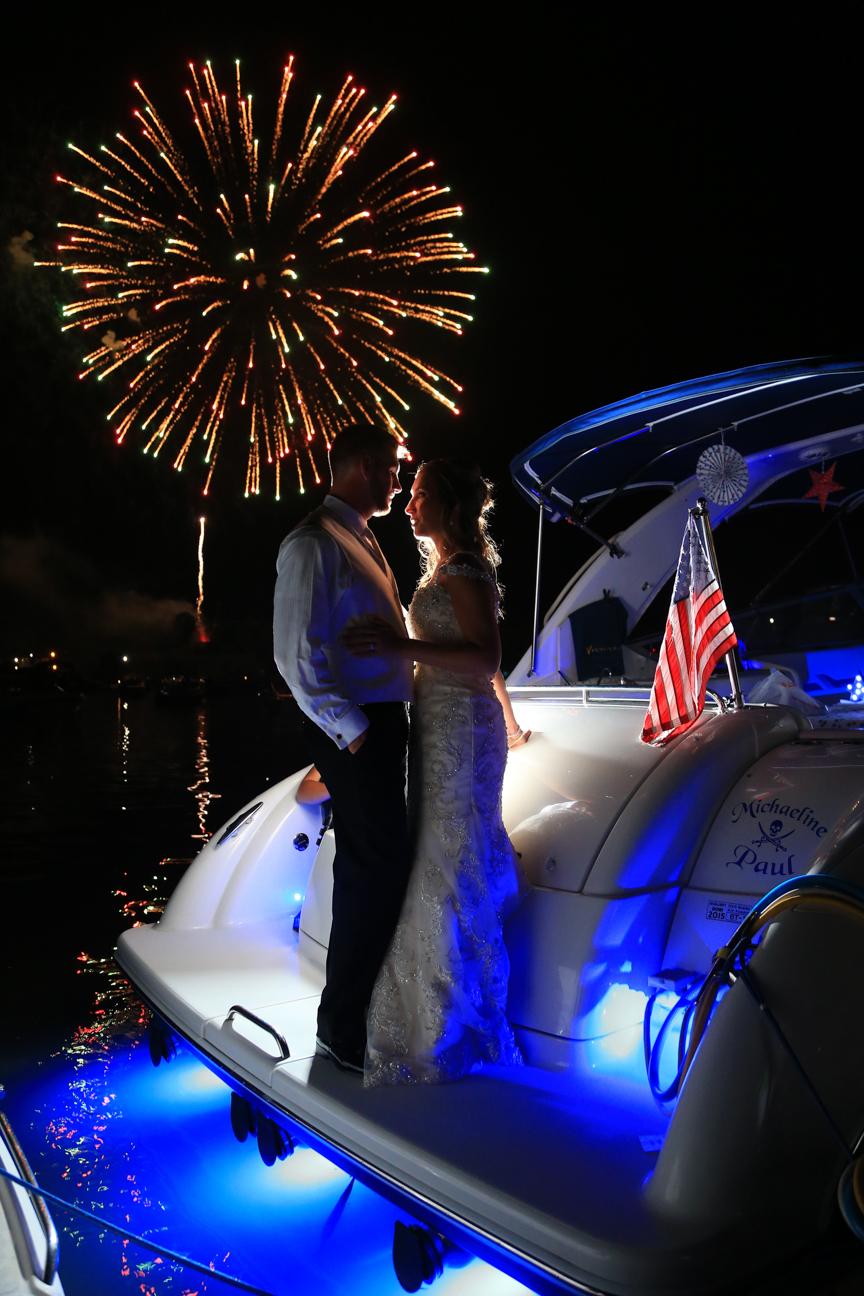 Bride and Groom on boat with fireworks Chesapeake City Maryland wedding photographer | Frederick Wedding Photographer