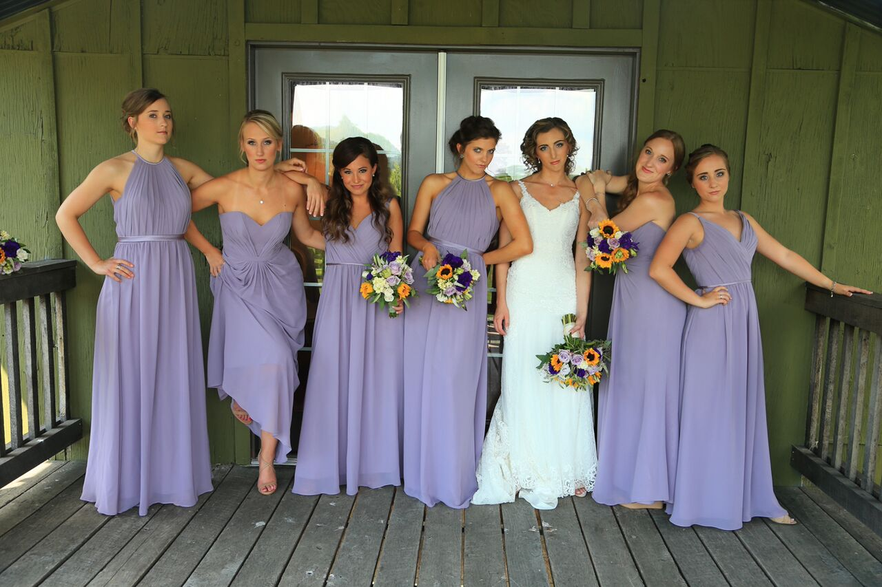 bride with bridesmaids having fun bluemont winery
