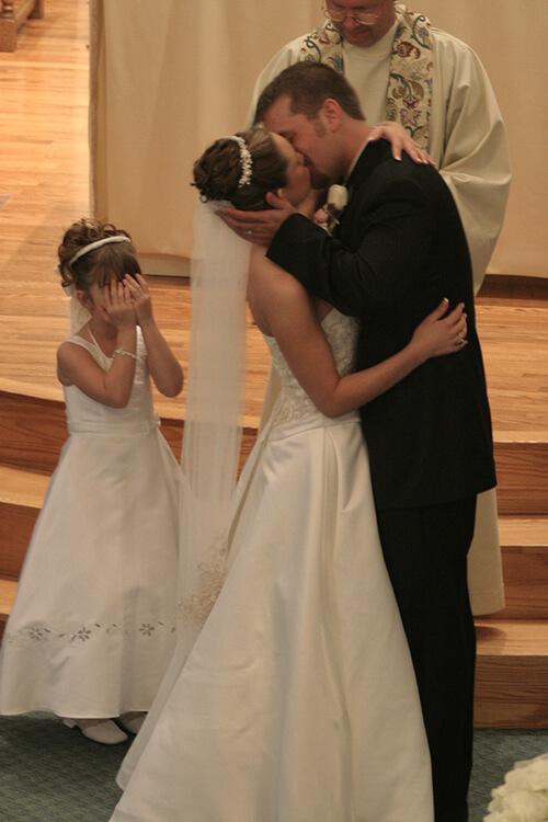Photojournalism Wedding Style Ceremony Photo with girl hiding eyes
