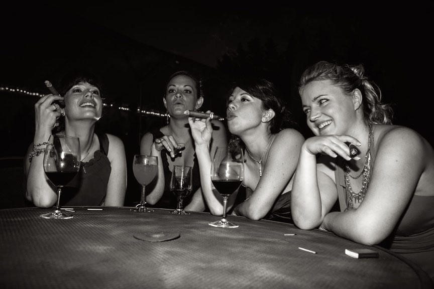 Documentary Wedding style at reception with girls smoking cigars