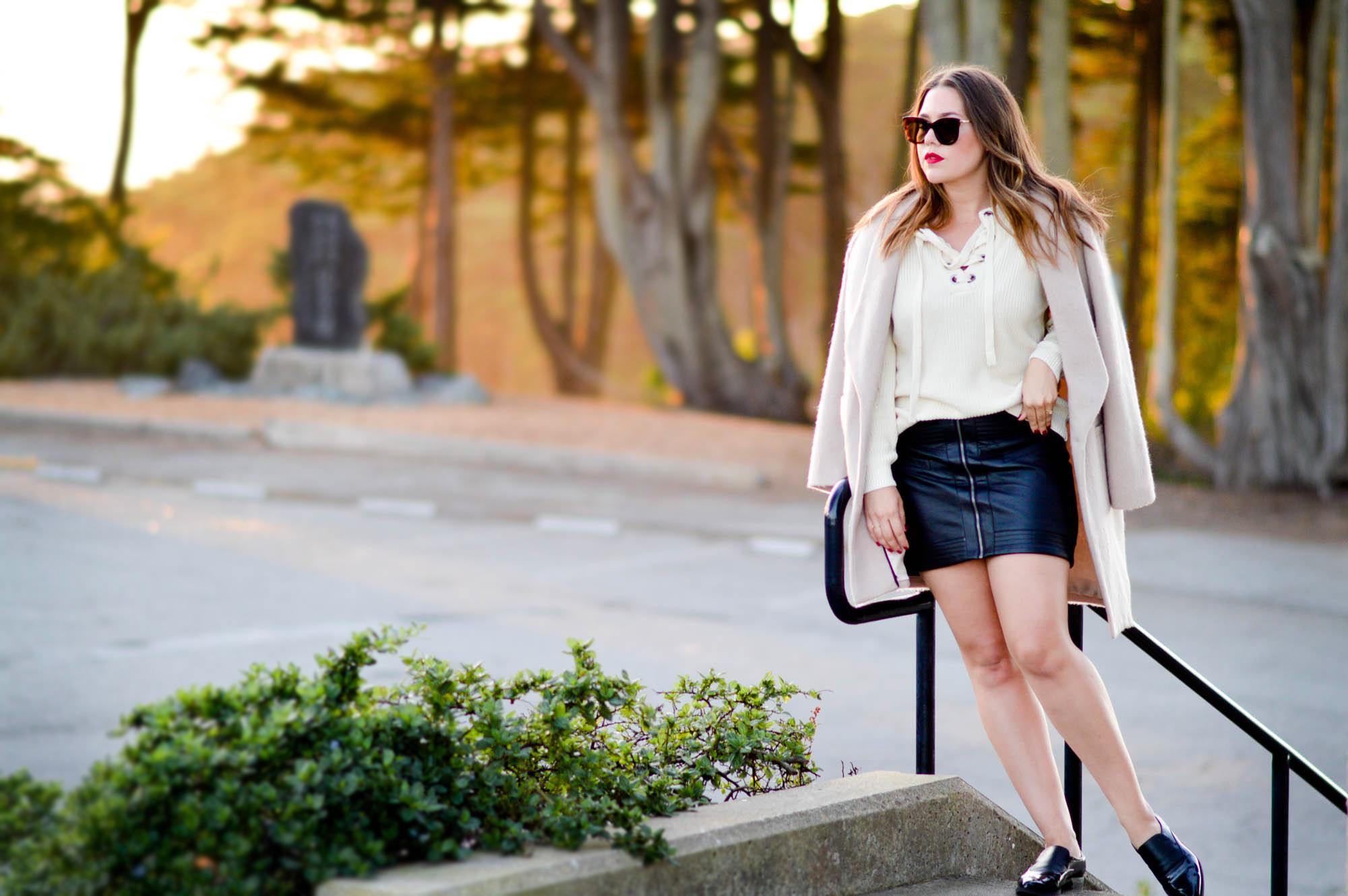 Lace-up cream sweater & leather skirt via. www.birdieshoots.com