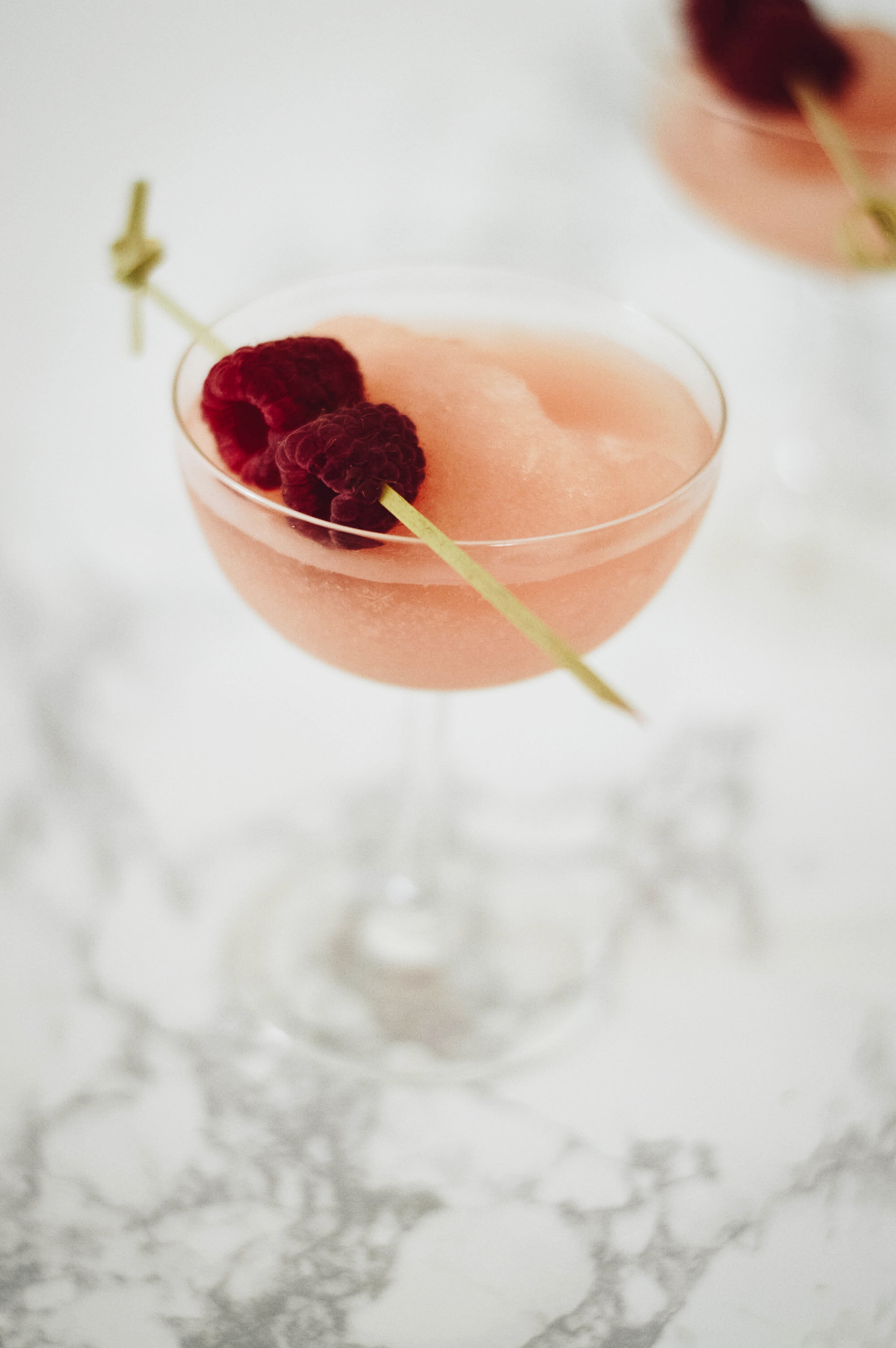 HOW-TO FROSE - - 1 Bottle Rose- 2 1/2 oz Lemon Juice- 1/2 C Sugar- 1/2 C Water- RaspberriesStart by pouring a bottle of rose into a ice cube tray, keep in mind that this will need to be done in advance! While the rose is chilling, start the simple syrup. In a sauce pan combine equal parts sugar and water. For this recipe I opted to do a 1/2 C of both. Heat until sugar is dissolved. Once rose has chilled, combine with simple syrup, 2 1/2 oz. lemon juice, rose cubes, and blend. For a slushier beverage you can also include additional ice.Serve with fresh berry garnish and enjoy!