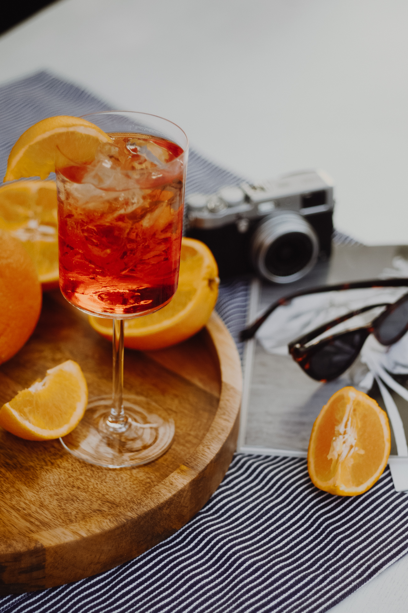 HOW-TO APEROL SPRITZ COCKTAIL - - Ice-Aperol- Prosecco DOC- Soda Water- Orange (sliced)Fill a wine glass with ice chips. Next, pour equal parts Prosecco and Aperol. Add a dash of soda water, being careful not to overfill the glass. Garnish with orange slice and enjoy!