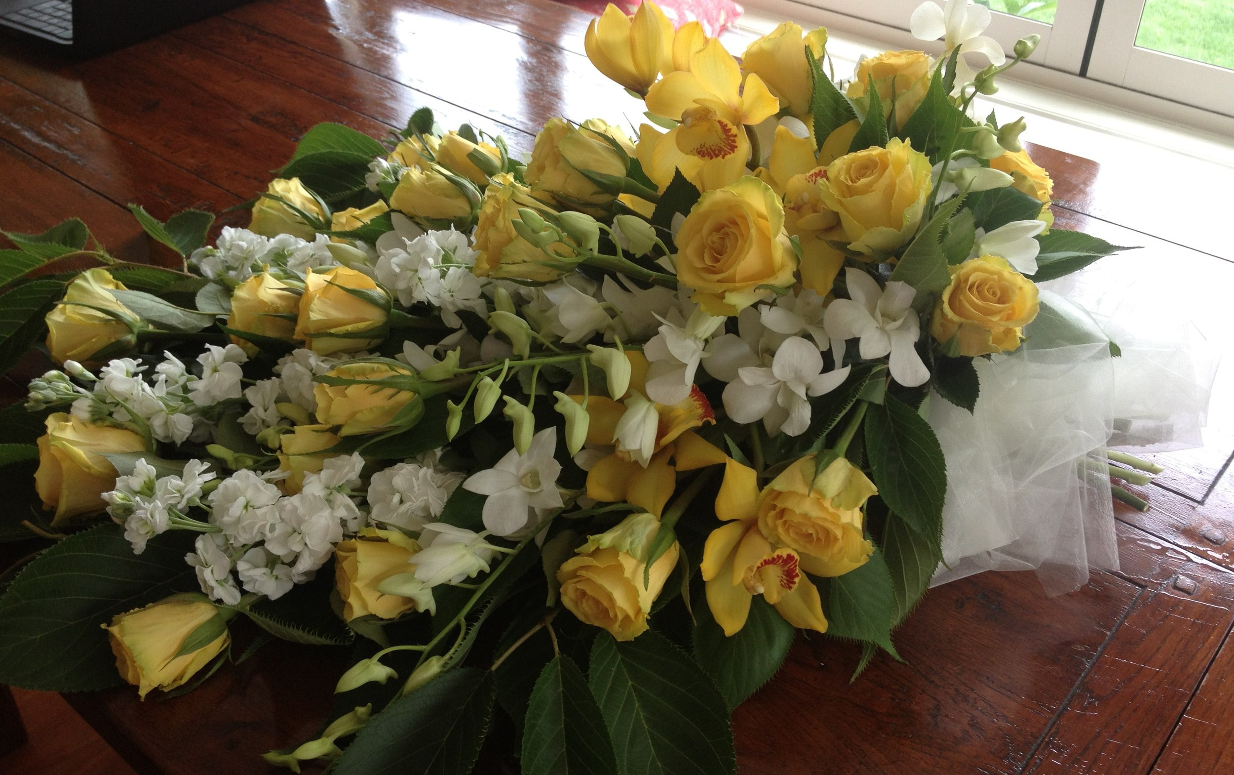 Yellow Roses, White Stock, Singapore and CymbidiumOrchids.