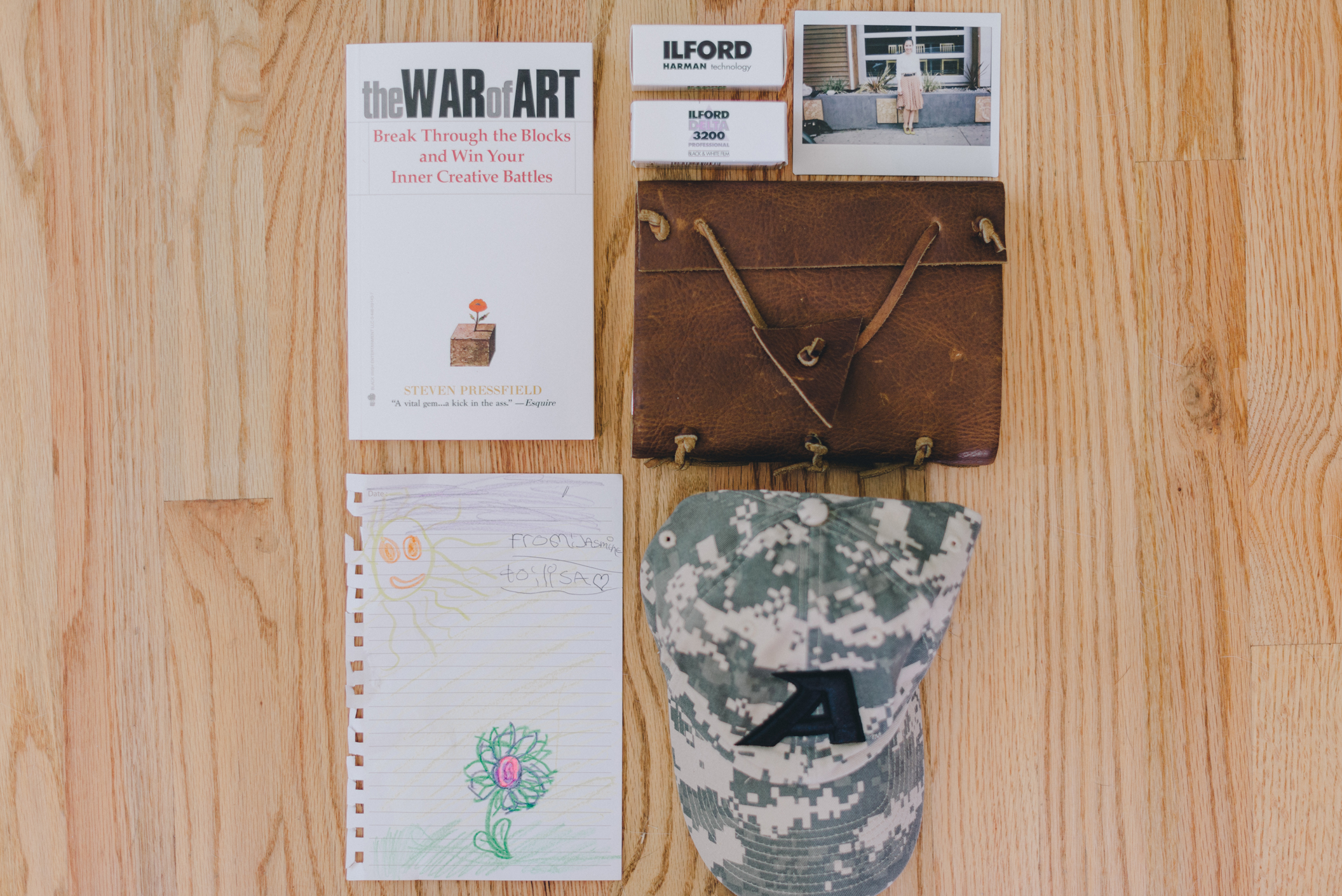 This week's favorites: The War of Art - book highly recommended by Ryan. Film. Journal filled with new artists to learn about. A drawing from Dana Napoleon's daughter (Dana also attended Musea). And Anthony's cap as he's been away for work.