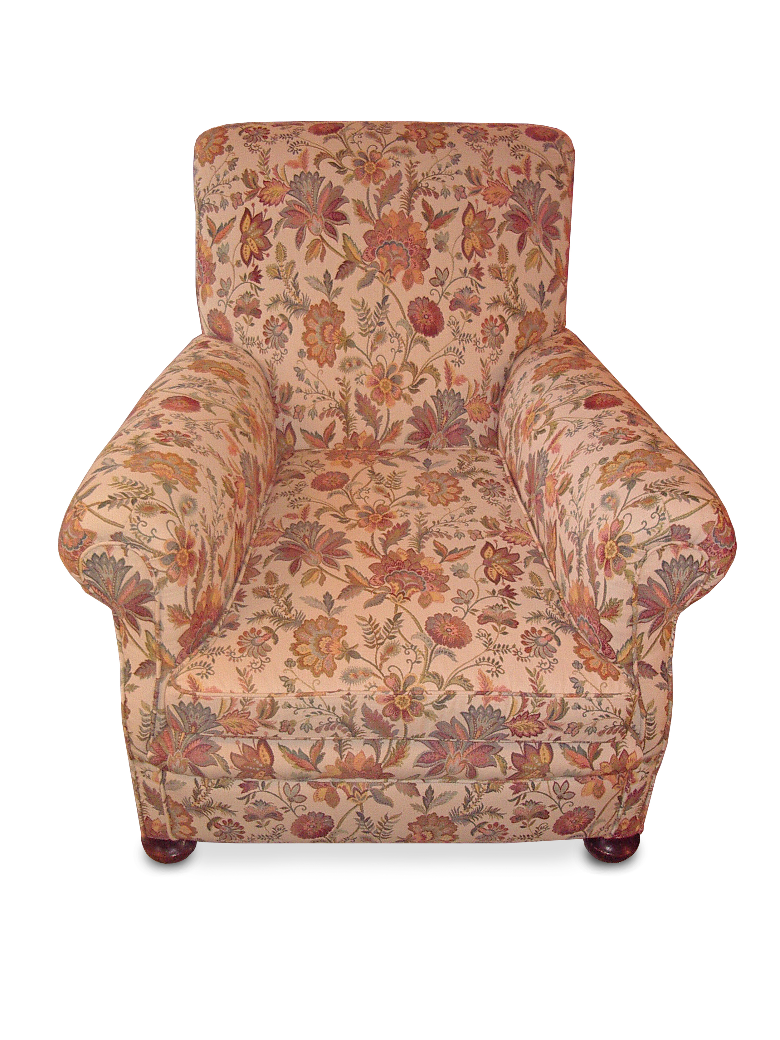 Classic armchair in striking flower pattern fabricrunning throughoutthe chair, stitched facing arms and feather/down cushion with bun feet