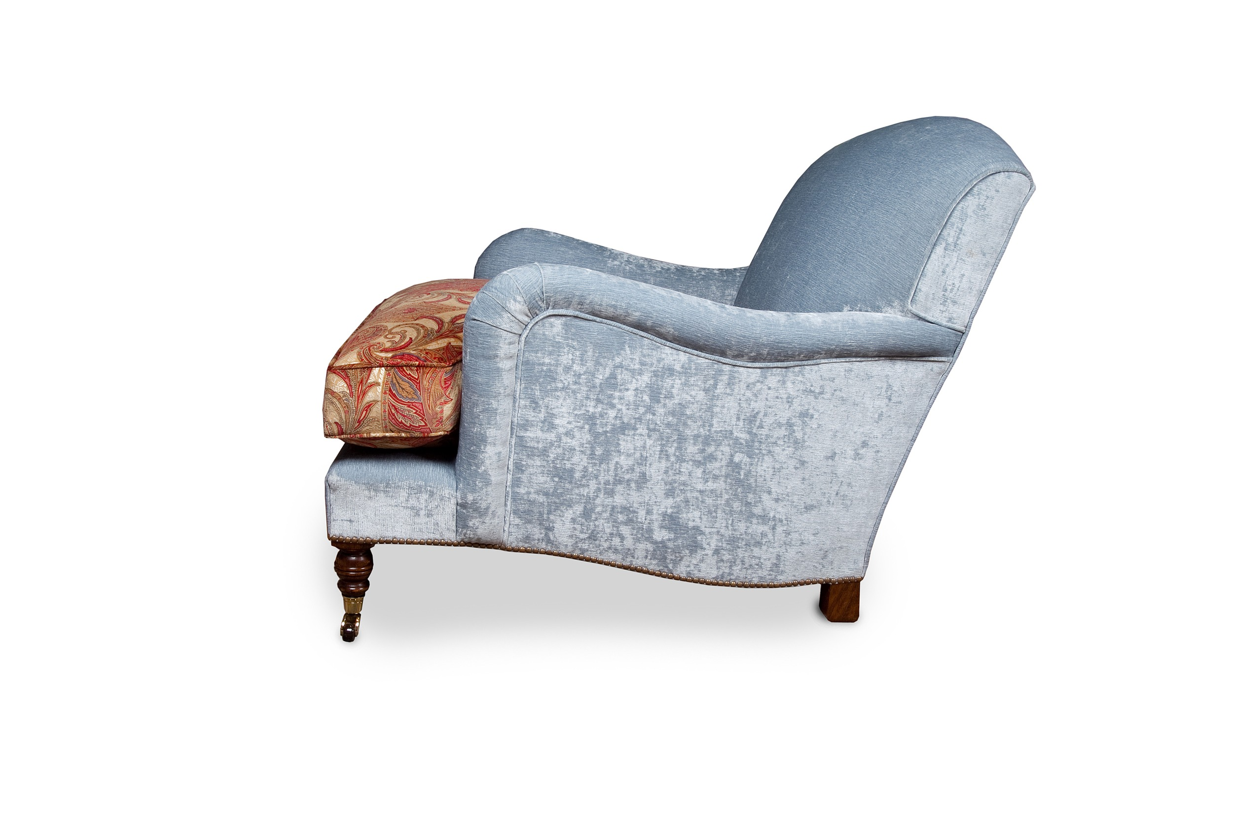 """""""Howard"""" armchair with brass and brown ceramic castors, feather down cushion andbase railstrimmed with individual antique brass nail heads"""