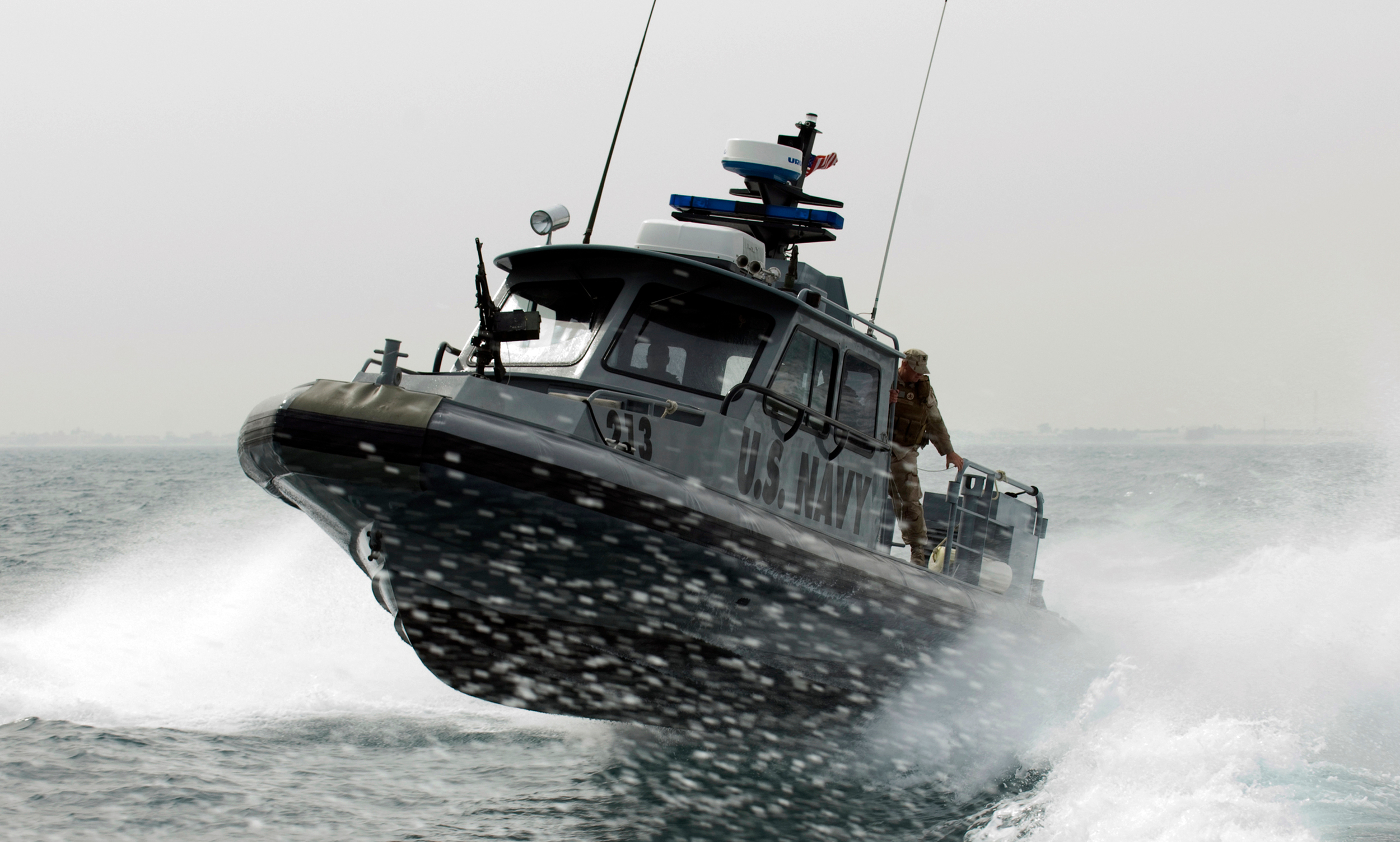 US_Navy_090210-N-9671T-144_A_port_security_boat_patrols_the_waters_near_Kuwait_Naval_Base.jpg