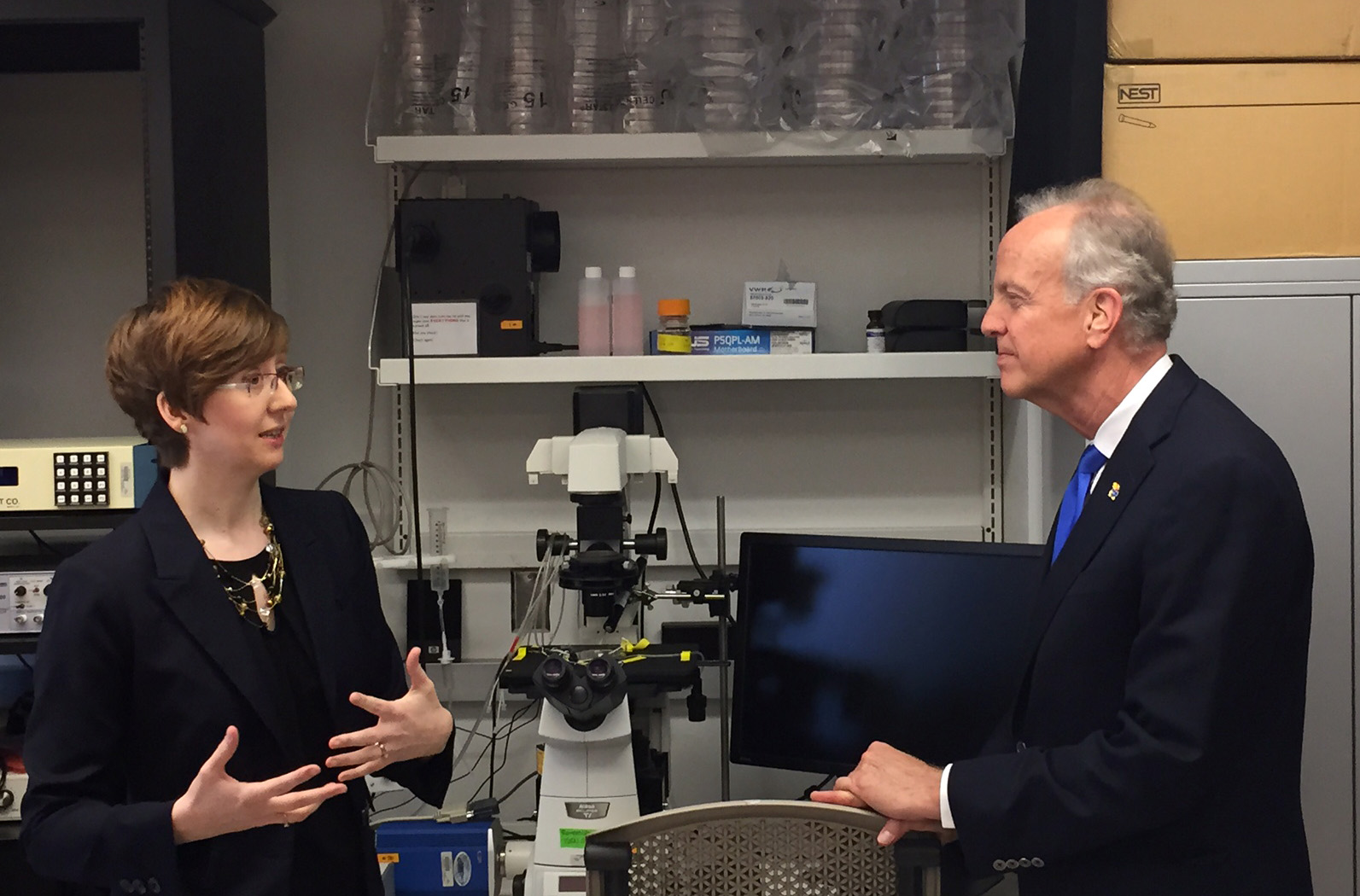 Pierce discusses the importance of federal investment in biomedical research with Senator Jerry Moran during a personal tour of the laboratory:  April 6, 2015.