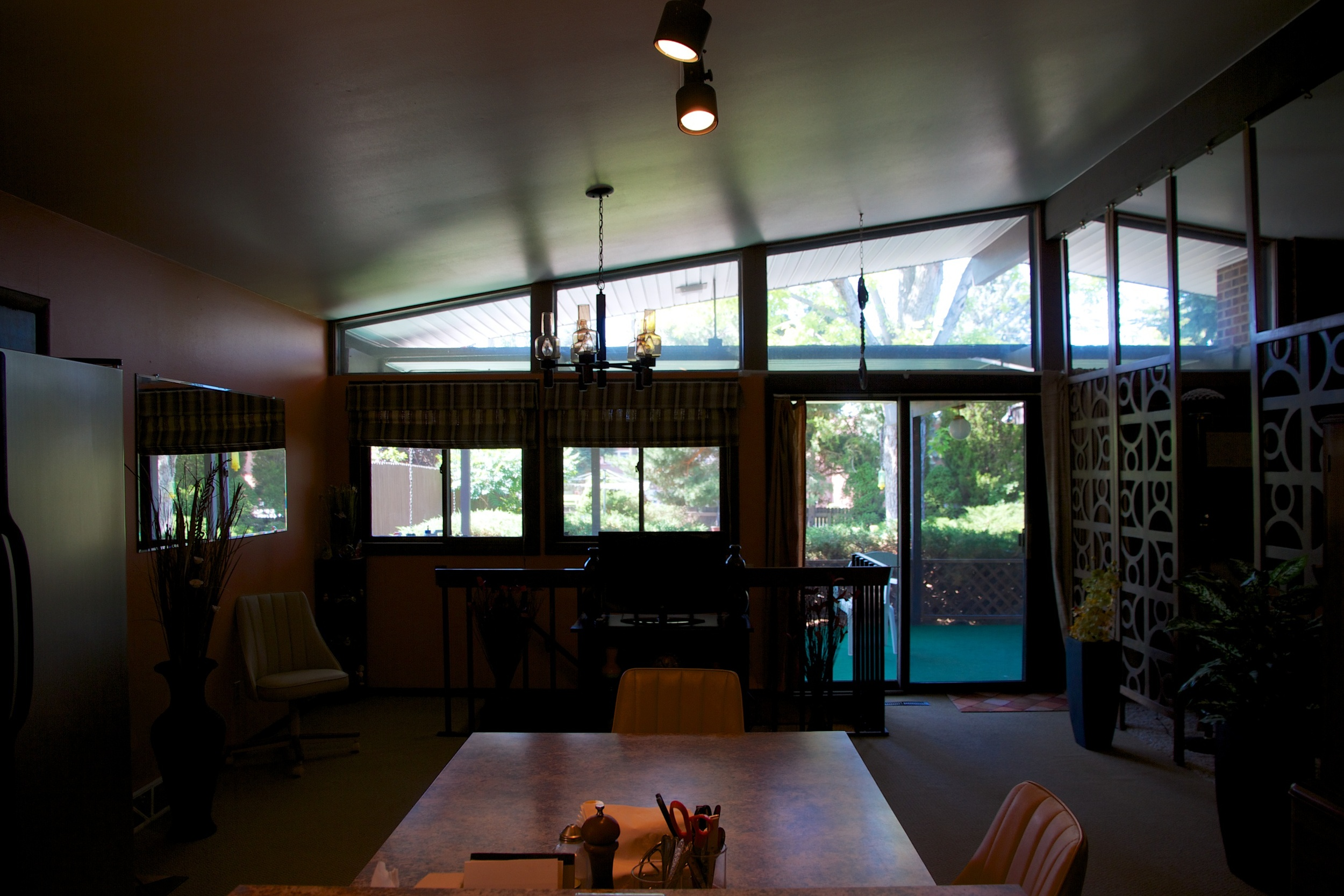 View from kitchen to back patio. Larger windows will replace existing to open up to the back.