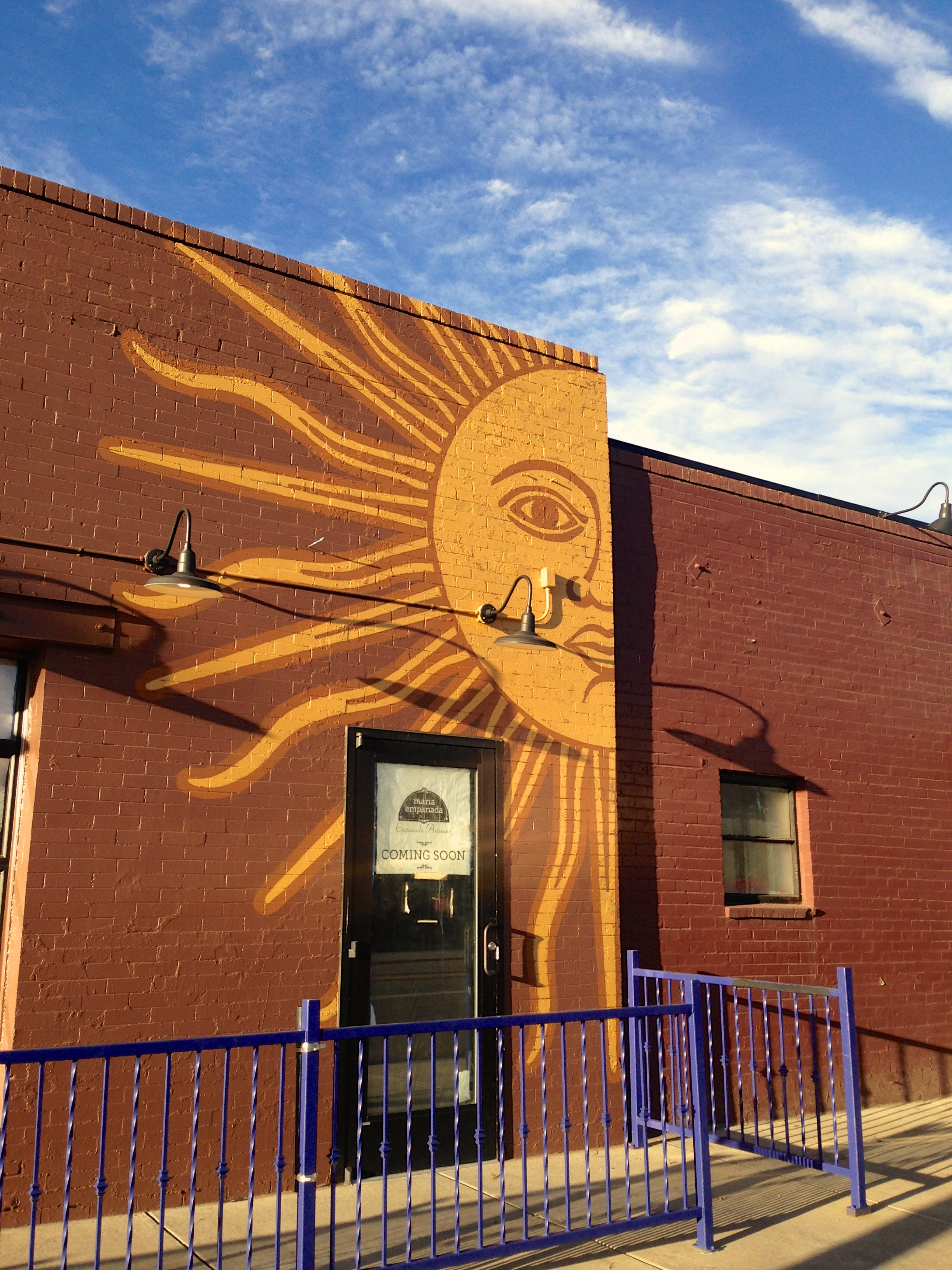Half sun mural completed on the south side.
