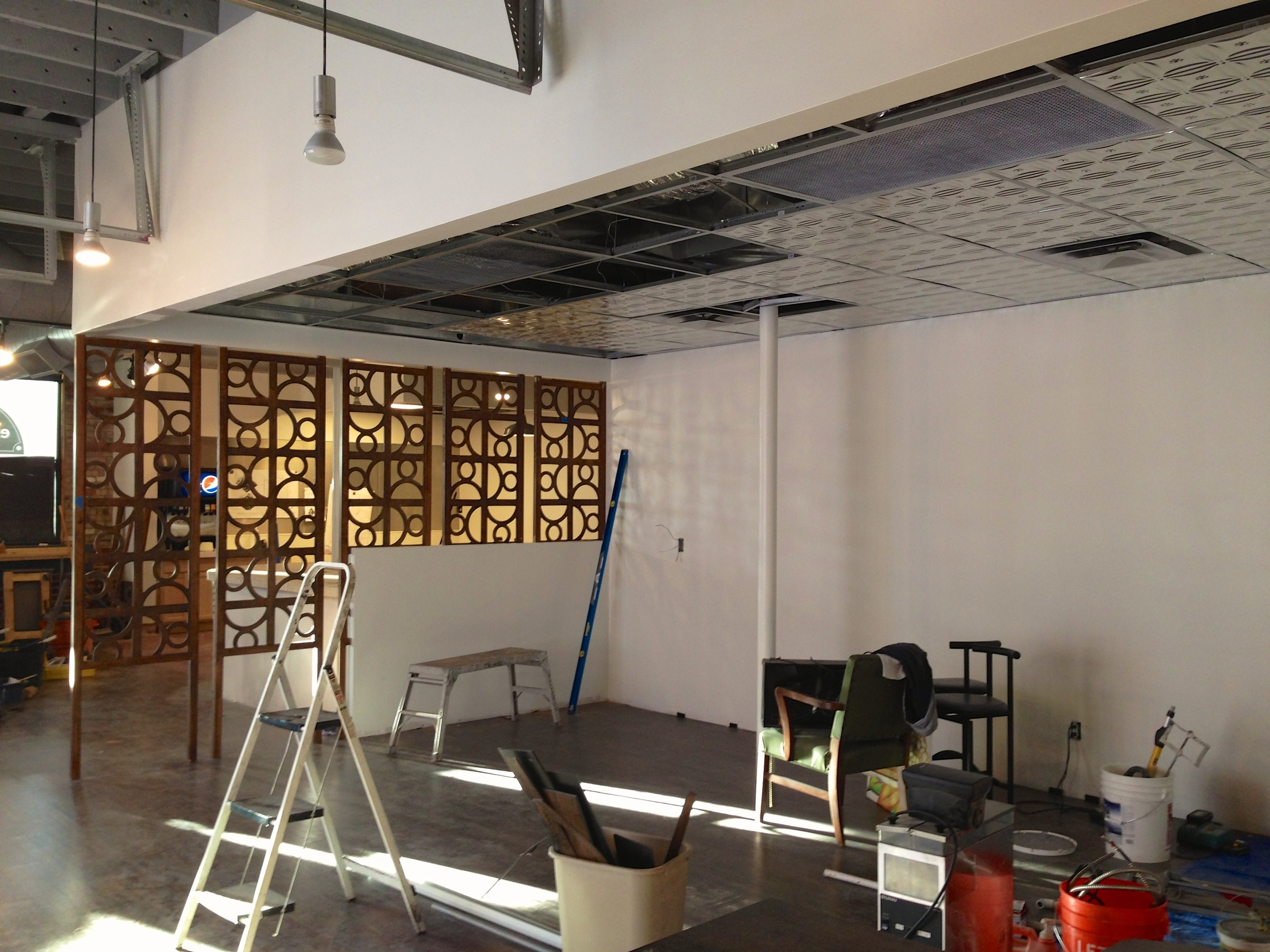 Decorative panels go up during construction.