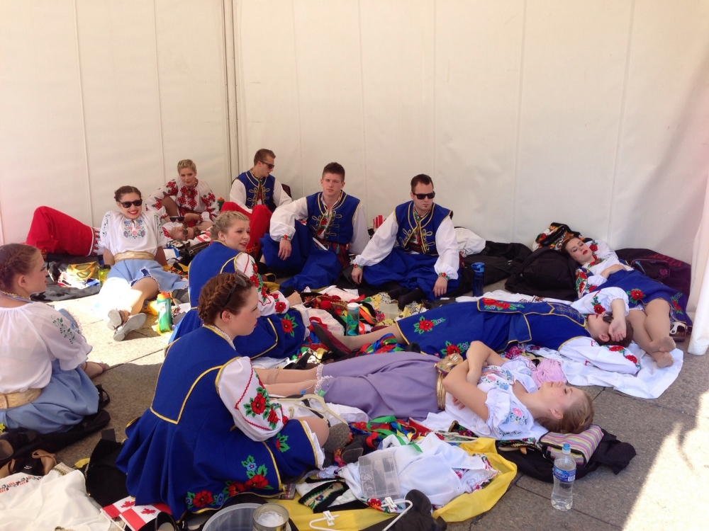 Prior to wowing the crowd here this morning in Zagreb, the dancers rest in the tent out of the sun.