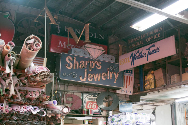 A collection of old signs from around Maury County are housed in the ceiling of their shop on Nashville Highway.