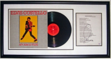 Elvis Costello Signed My Aim Is True Album & Lyric Sheet Compilation - PSA DNA COA Authenticated - Professionally Framed 34x16
