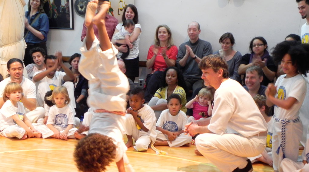 How do we promote achievement, leadership and community through capoeira?