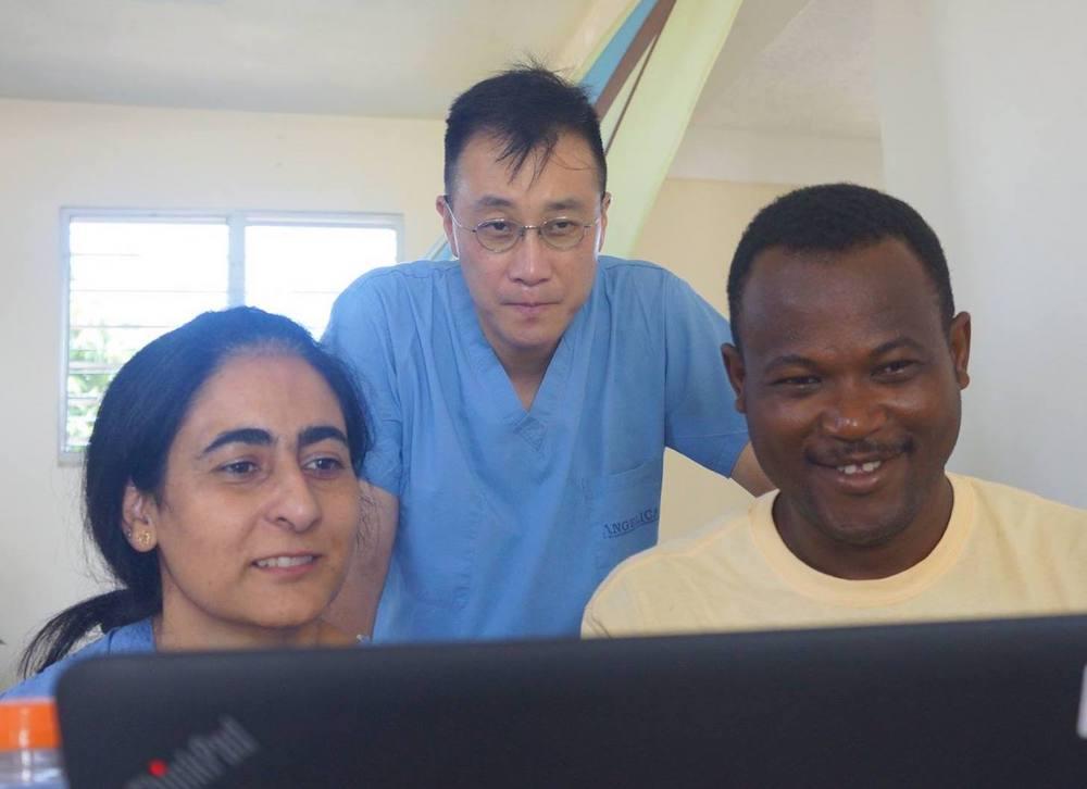 Uzma Alam (left), Michael Seo, and Pierre Evens Jean-Louis review health data at  Klink Fonfrèd , Haiti