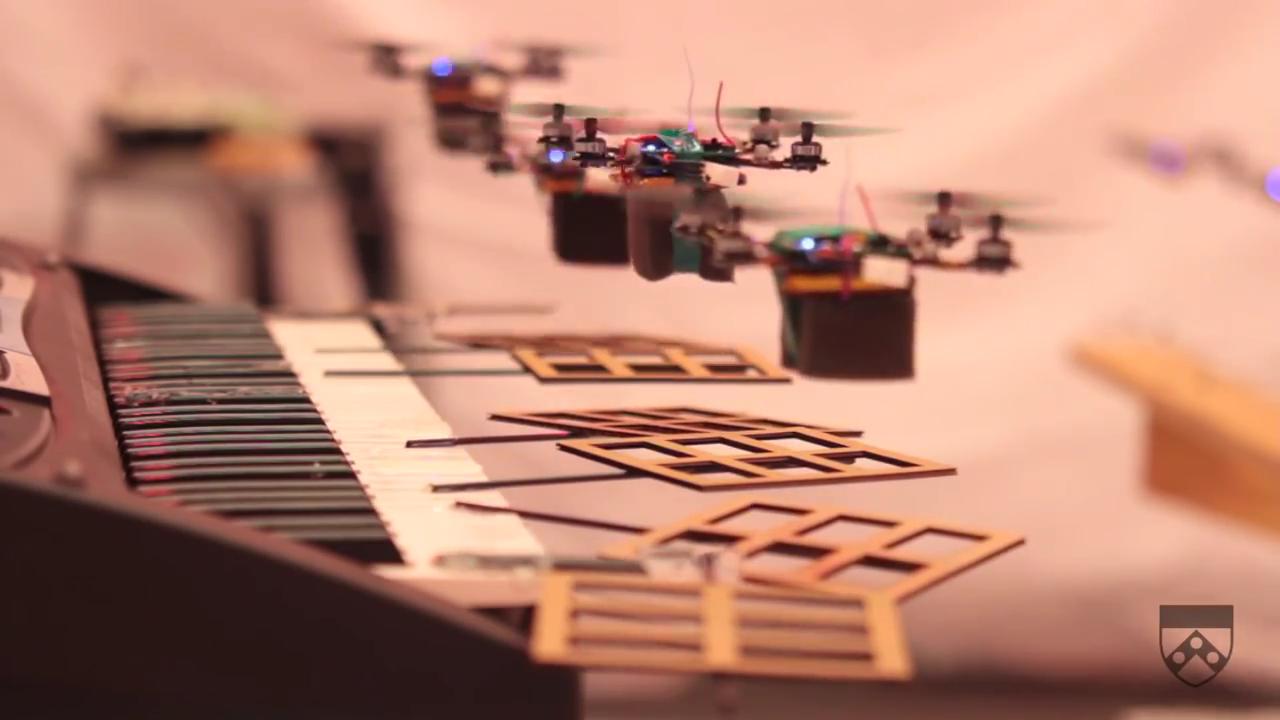 Robot Quadrotors Perform James Bond Theme  by Kurtis Sensenig