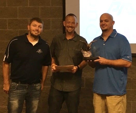 James Brett Kennard - APM Fossil North - President's AwardBrett (right) pictured with Steve Bingle, North EHS Manager (left) and Eric Sielaff, Fossil North Director (middle)