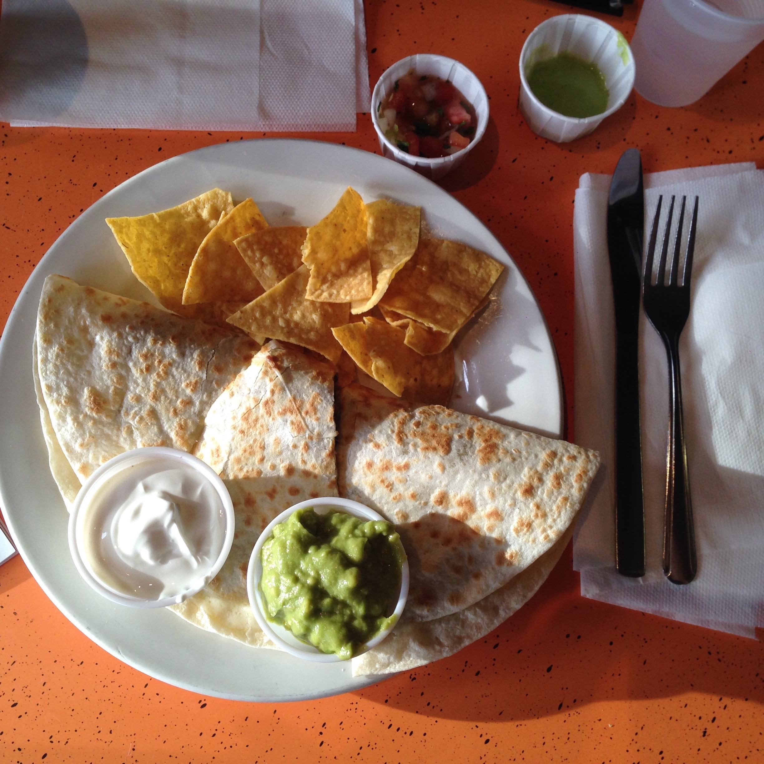 steak quesadilla with a side of sour cream and guac - perfection.
