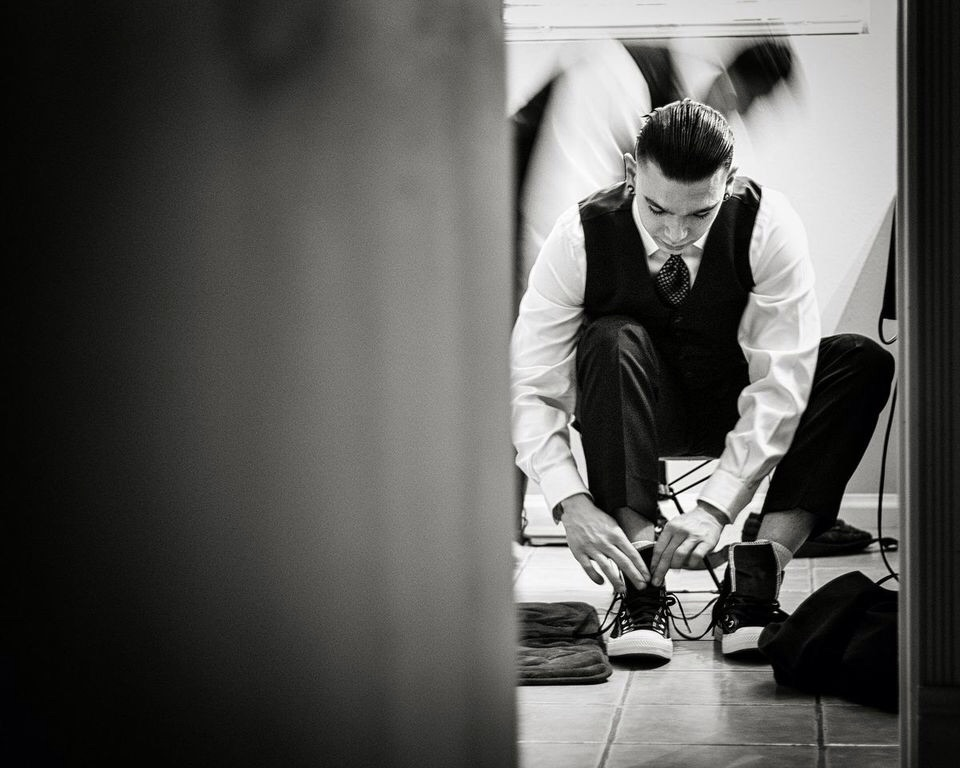 The Groom: lacing up the Chucks