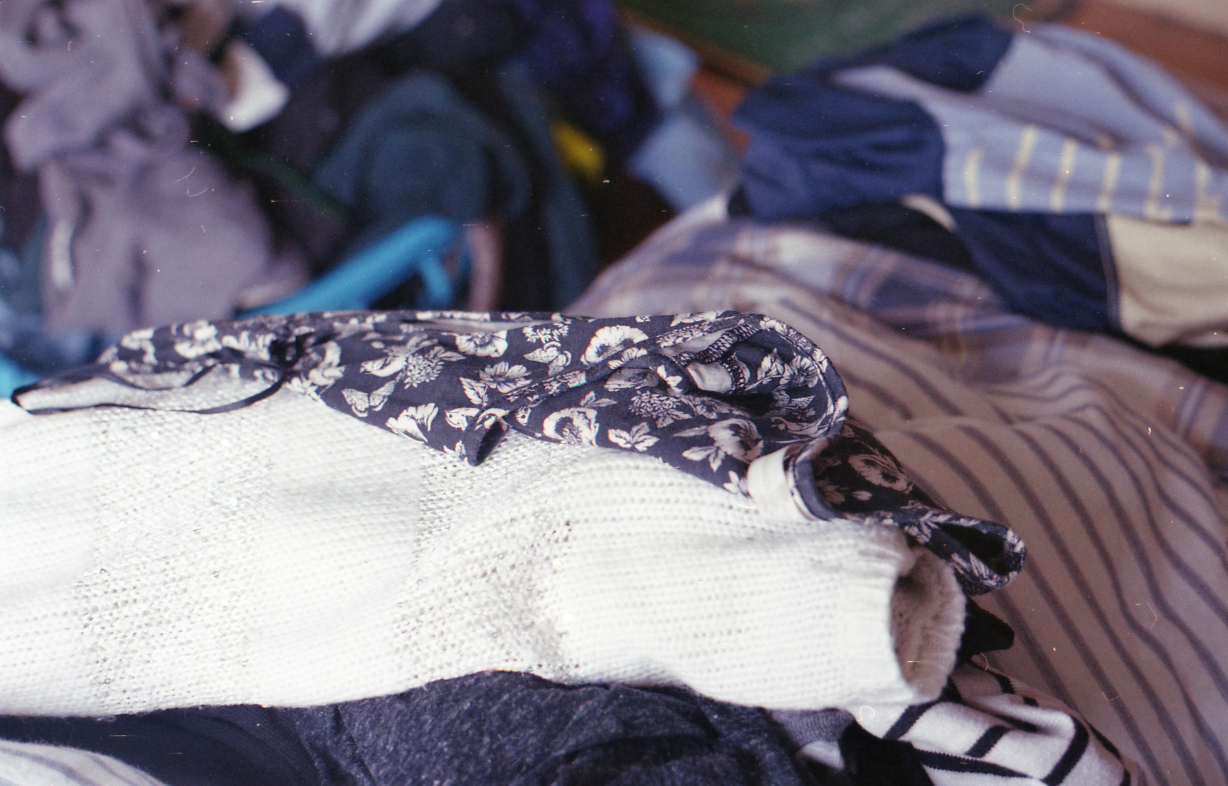 10/366 -I think this is my favourite yet even if it's just clothes on our bed (being in focus helps)