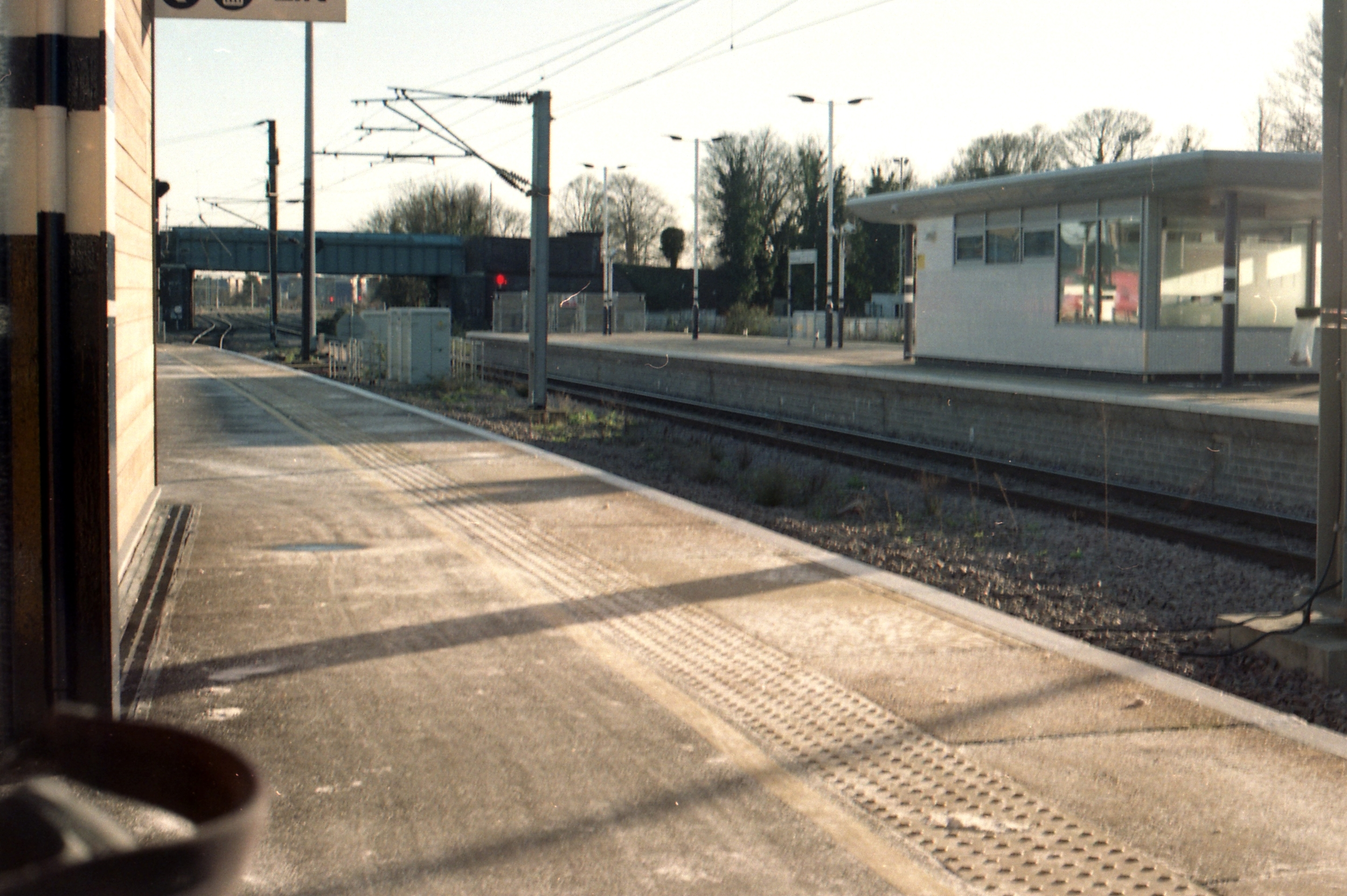 15/366 - Waiting for my next train in Peterborough in the sunshine. What you can't see is the very large tea I also had as it was freezing!