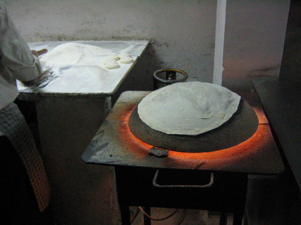 Making rotis  Photo credit:  Lian Chang