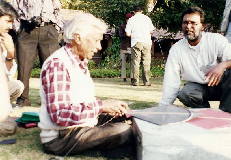 Ajay Prakash looks on as Babu Khan makes a fighter kite Photo courtesy Ajay Prakash